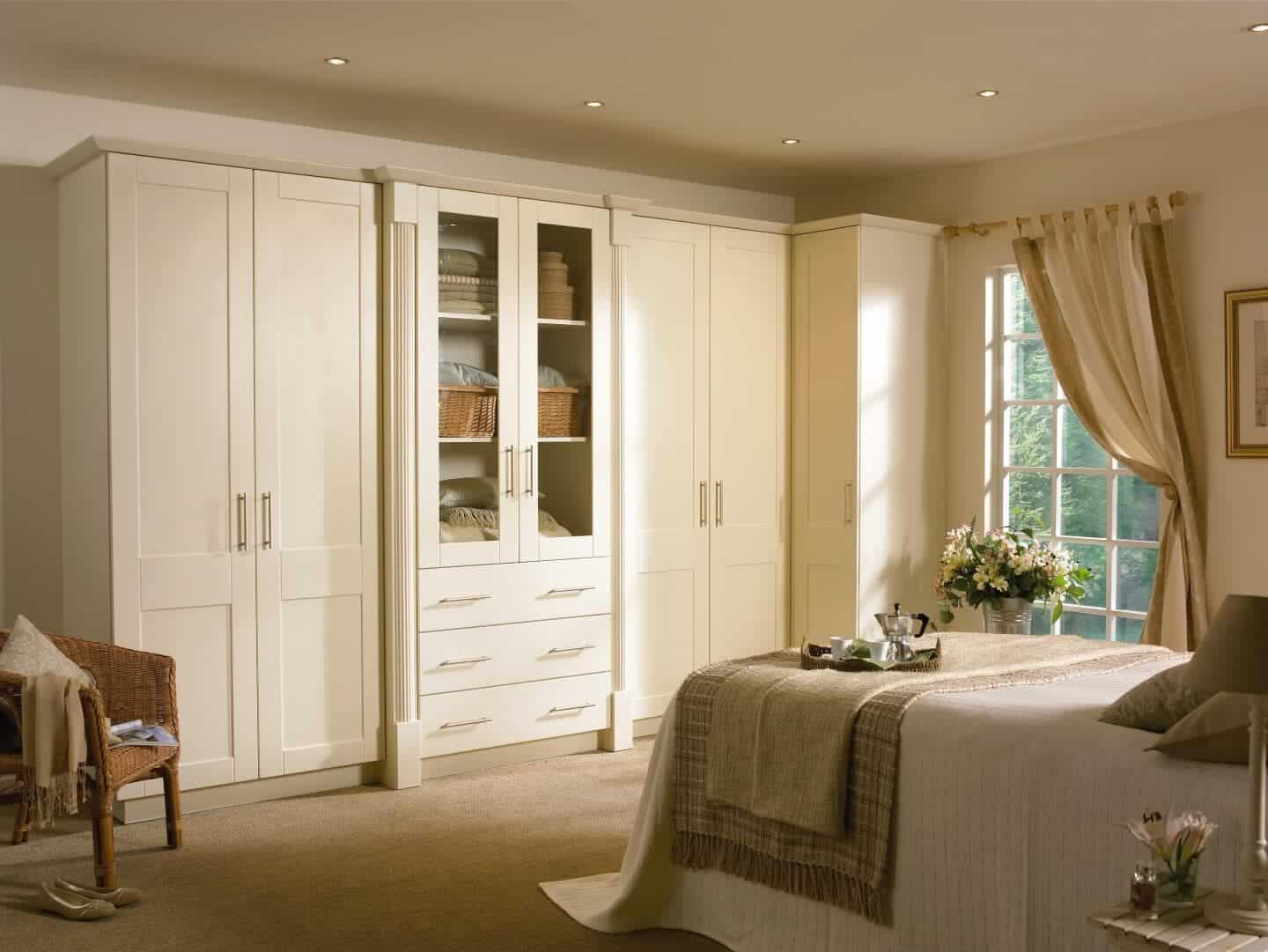 white bedrooom with two closets and bed