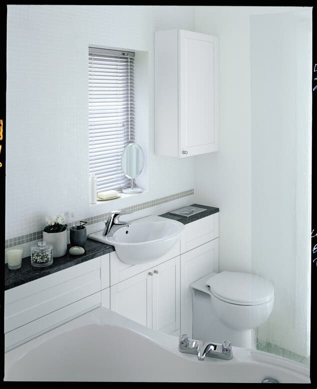 White bathroom with toilet and sink