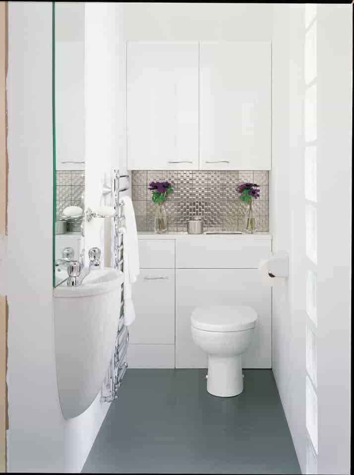 White small bathroom with blue floor