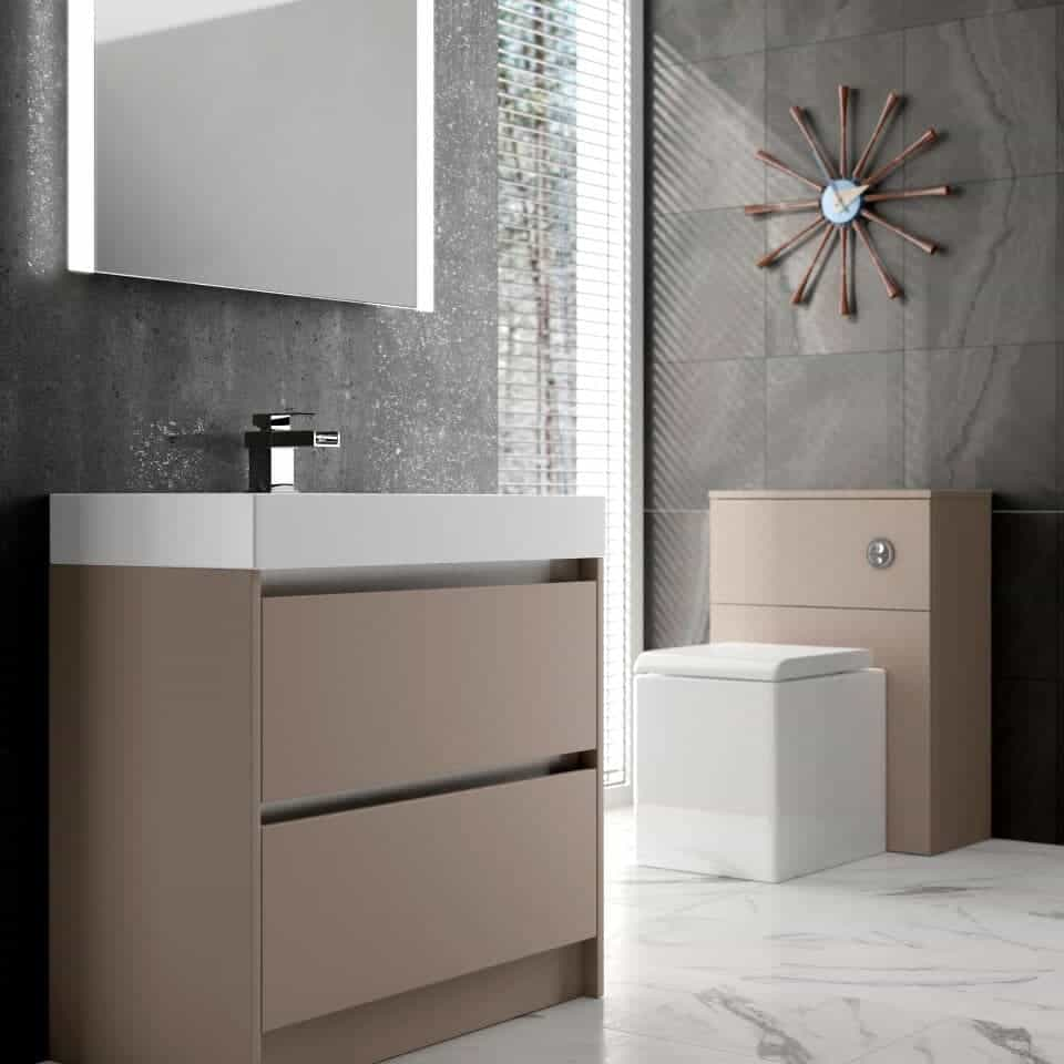 bathroom with beige furniture and mirror